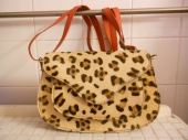 Leather and animal print saddle style bag