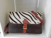 Leather and animal print saddle bag